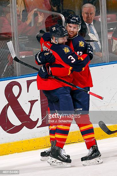 Jimmy Hayes of the Florida Panthers celebrates his goal with teammate Steven Kampfer against the Anaheim Ducks at the BBT Center on February 10 2015...