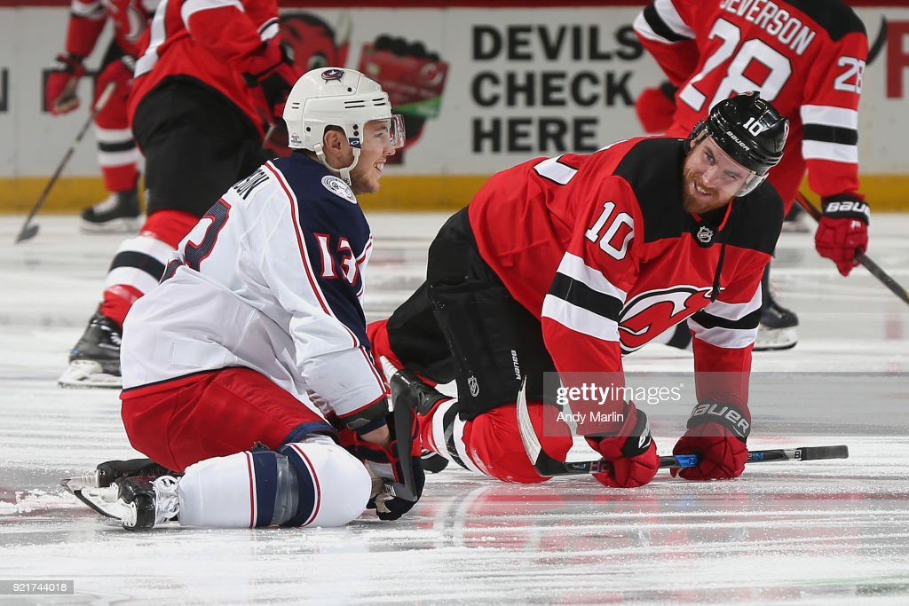 Jimmy Hayes #10 of the New Jersey Devils and Cam Atkinson #13 of the Columbus Blue Jackets chat during warm-ups prior to the game at Prudential Center on February 20, 2018 in Newark, New Jersey.
