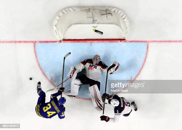 Jimmy Howard goaltender of USA makes a save against Sweden during the 2017 IIHF Ice Hockey World Championship game between USA and Sweden at Lanxess...