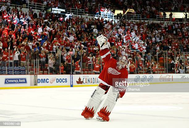 Jimmy Howard of the Detroit Red Wings acknowledges fans after being names the first star of the game after defeating the Chicago Blackhawks 20 in...