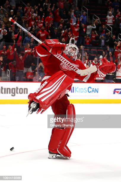 Jimmy Howard of the Detroit Red Wings celebrates a shootout save to beat the Vancouver Canucks 32 at Little Caesars Arena on November 06 2018 in...