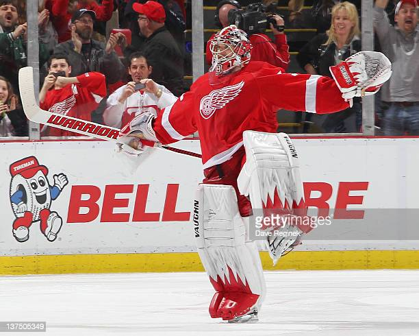 Jimmy Howard of the Detroit Red Wings celebrates his shootout win after an NHL game against the Columbus Blue Jackets at Joe Louis Arena on January...