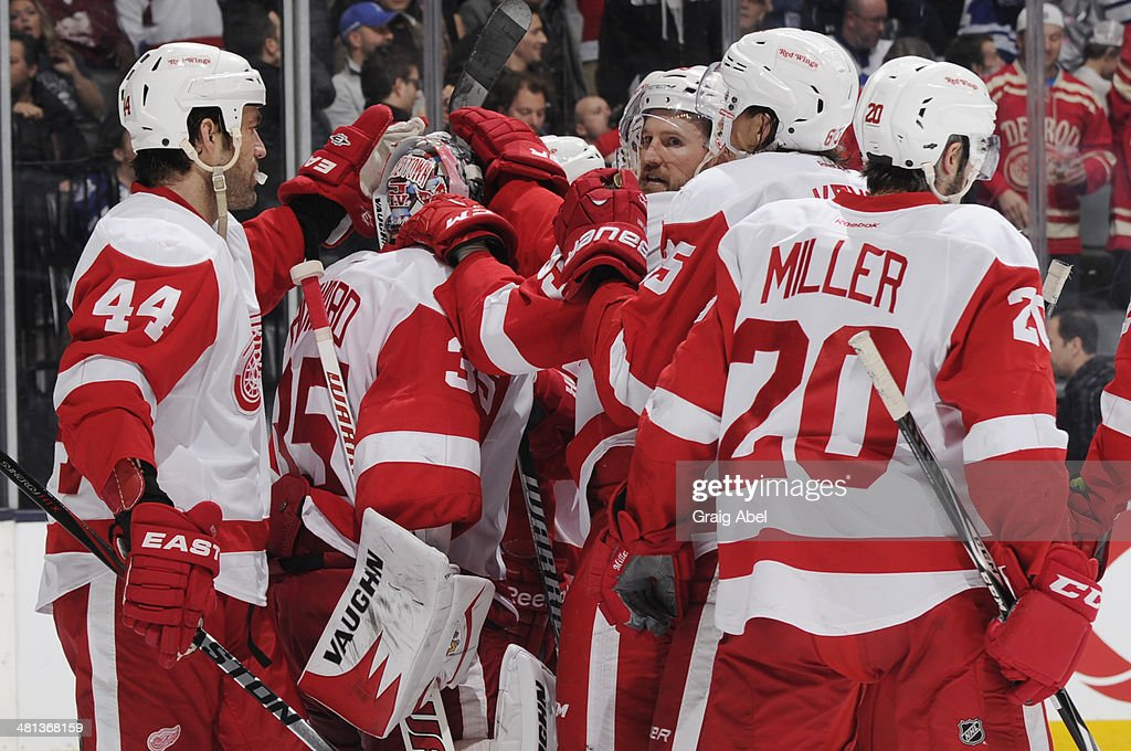 Jimmy Howard #35 of the Detroit Red Wings celebrates the teams win over the Toronto Maple Leafs during NHL game action March 29, 2014 at the Air Canada Centre in Toronto, Ontario, Canada.