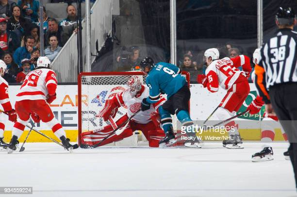 Jimmy Howard of the Detroit Red Wings defends the net against Evander Kane of the San Jose Sharks at SAP Center on March 12 2018 in San Jose...