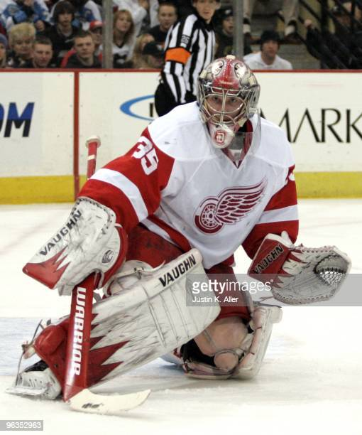 Jimmy Howard of the Detroit Red Wings eyes a puck in the corner against the Pittsburgh Penguins at Mellon Arena on January 31 2010 in Pittsburgh...