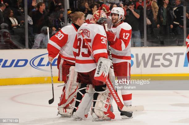 Jimmy Howard of the Detroit Red Wings is congratulated by teammate Patrick Eaves after defeating the Los Angeles Kings on January 7 2010 at Staples...