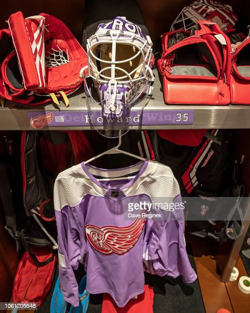 Jimmy Howard of the Detroit Red Wings locker set up with the Hockey Fights Cancer uniform and mask that will be worn for warm-ups prior to an NHL...