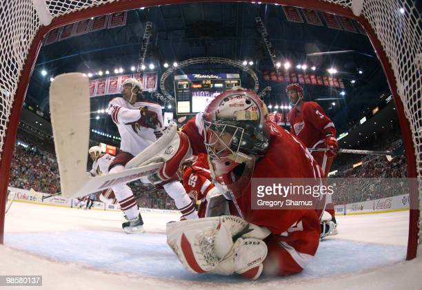 Jimmy Howard of the Detroit Red Wings looks back at the puck after making a third period save on the Phoenix Coyotes during Game Four of the Western...