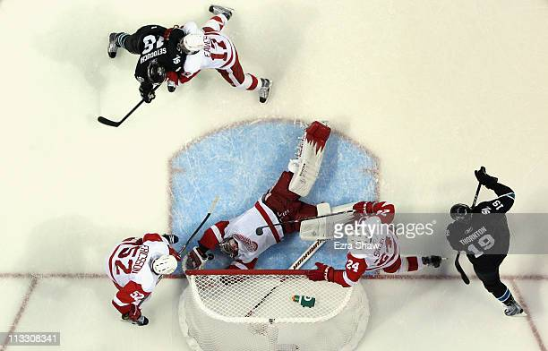 Jimmy Howard of the Detroit Red Wings makes a diving save in the second period of their game against the San Jose Sharks in Game Two of the Western...