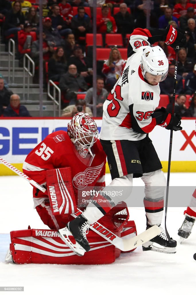 Jimmy Howard #35 of the Detroit Red Wings makes a first period save on Colin White #36 of the Ottawa Senators at Little Caesars Arena on March 31, 2018 in Detroit, Michigan.