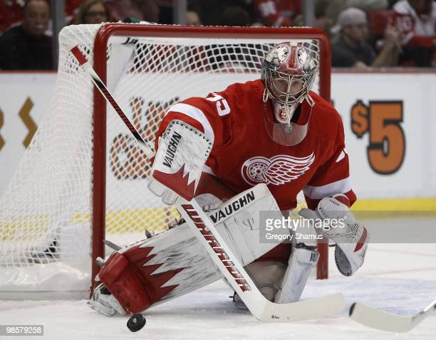 Jimmy Howard of the Detroit Red Wings makes a firstperiod save against the Phoenix Coyotes during Game Four of the Western Conference Quarterfinals...