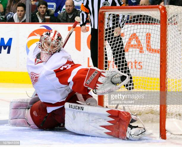 Jimmy Howard of the Detroit Red Wings makes a glove save during their game at Rogers Arena on January 8 2011 in Vancouver British Columbia Canada...
