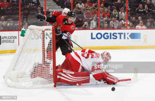 Jimmy Howard of the Detroit Red Wings makes a save against a scoring chance by Mike Hoffman of the Ottawa Senators at Canadian Tire Centre on...