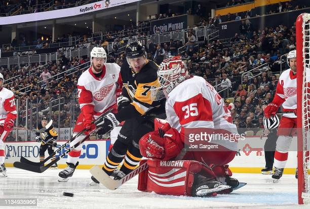 Jimmy Howard of the Detroit Red Wings makes a save against Evgeni Malkin of the Pittsburgh Penguins at PPG Paints Arena on April 4 2019 in Pittsburgh...