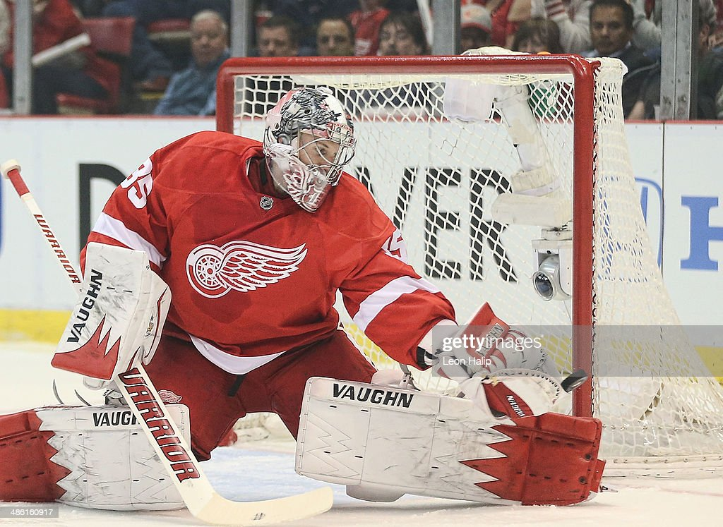 Jimmy Howard #35 of the Detroit Red Wings makes a save during the first period against the Boston Bruins during Game Three of the First Round of the 2014 NHL Stanley Cup Playoffs at Joe Louis Arena on April 22, 2014 in Detroit, Michigan. The Bruins defeated the Wings 3-0.