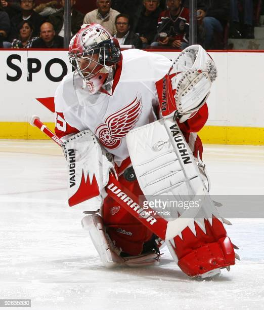 Jimmy Howard of the Detroit Red Wings makes a save during their game against the Vancouver Canucks at General Motors Place on October 27 2009 in...