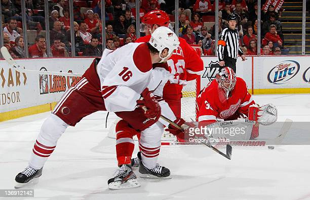 Jimmy Howard of the Detroit Red Wings makes a save on a shot by Rostislav Klesla of the Phoenix Coyotes during the third period at Joe Louis Arena on...