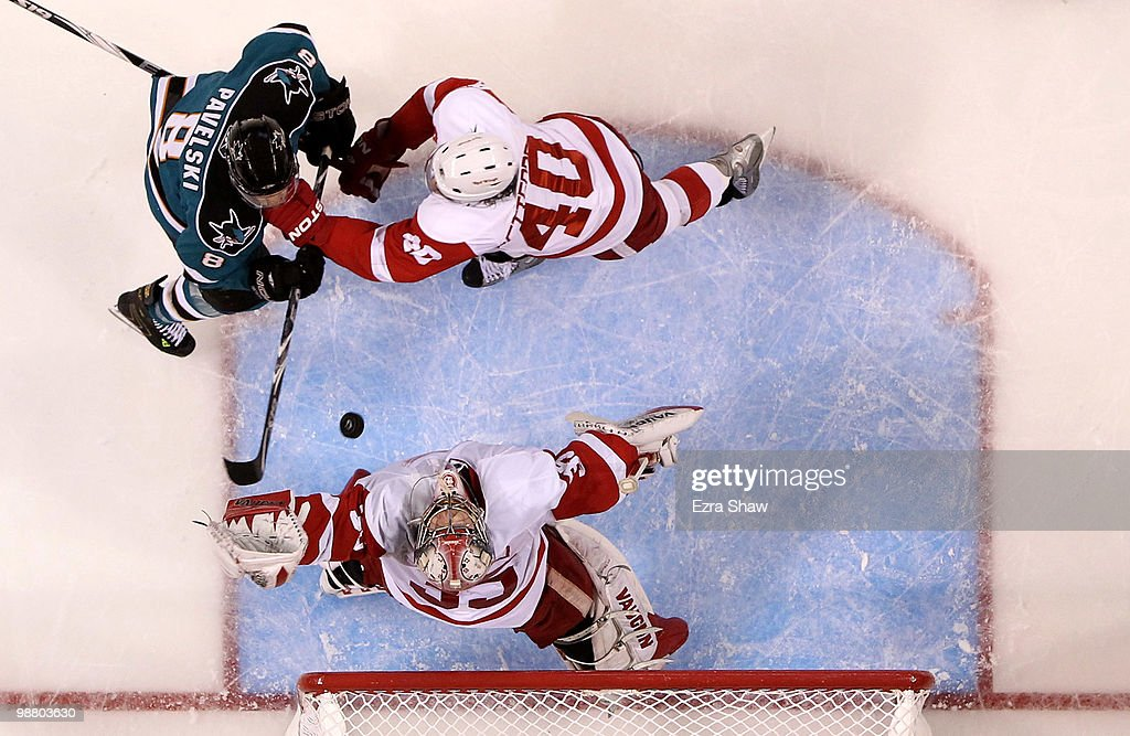 Jimmy Howard #35 of the Detroit Red Wings makes a save while teammate Henrik Zetterberg #40 fights for position with Joe Pavelski #8 of the San Jose Sharks in Game Two of the Western Conference Semifinals during the 2010 NHL Stanley Cup Playoffs at HP Pavilion on May 2, 2010 in San Jose, California.