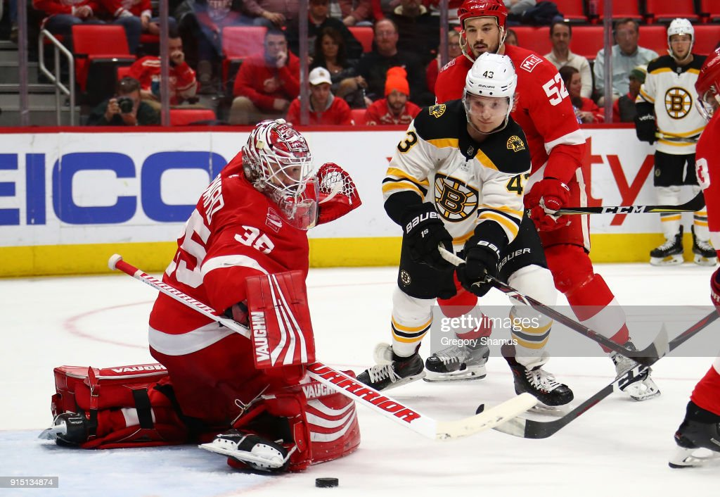Jimmy Howard #35 of the Detroit Red Wings makes a third period save on Danton Heinen #43 of the Boston Bruins at Little Caesars Arena on February 6, 2018 in Detroit, Michigan. Boston won the game 3-2.