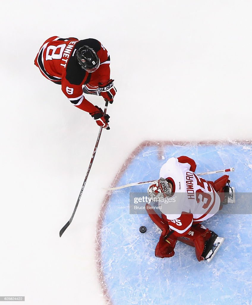 Jimmy Howard #35 of the Detroit Red Wings makes the save on Beau Bennett #8 of the New Jersey Devils at the Prudential Center on November 25, 2016 in Newark, New Jersey. The Red Wings defeated the Devils 5-4 in overtime.