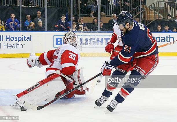 Jimmy Howard of the Detroit Red Wings makes the second period save against Rick Nash of the New York Rangers at Madison Square Garden on April 9 2016...