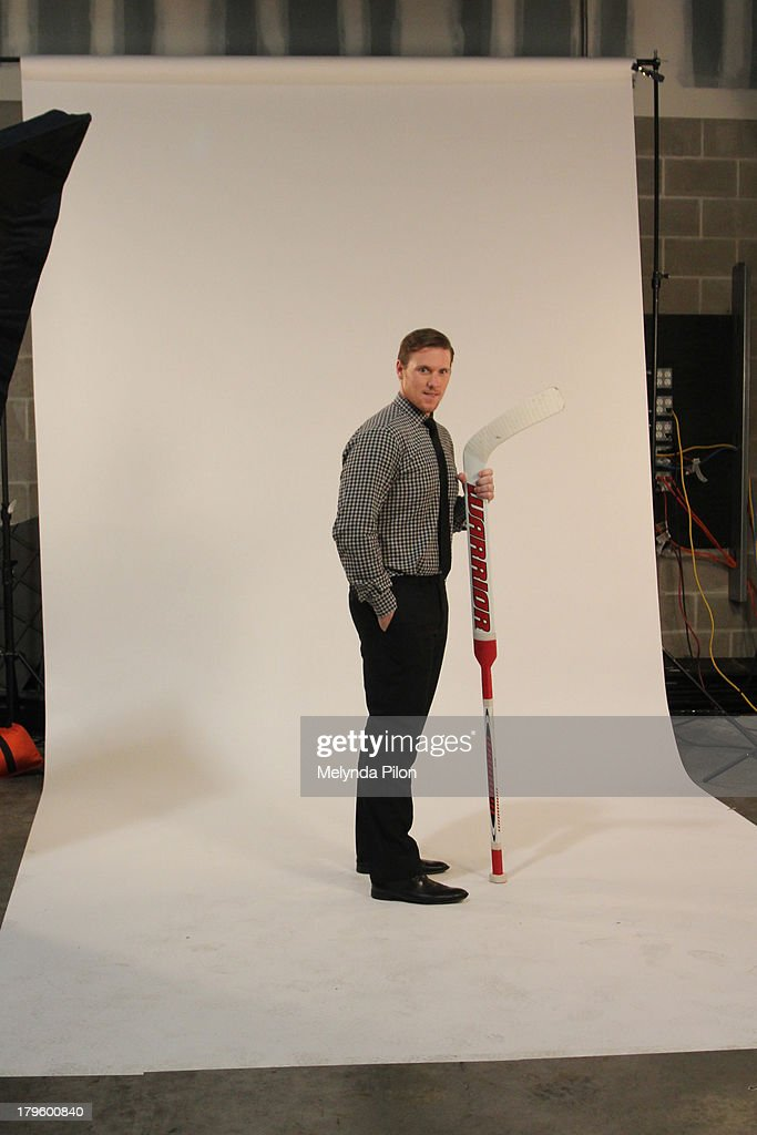 Jimmy Howard of the Detroit Red Wings poses for a photo shoot at the 2013 NHL Player Media Tour at the Prudential Center on September 5, 2013 in Newark, New Jersey.