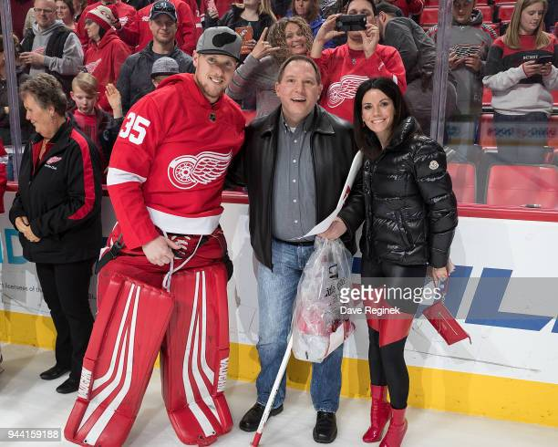 Jimmy Howard of the Detroit Red Wings poses with season ticket holders following an NHL game against the New York Islanders at Little Caesars Arena...