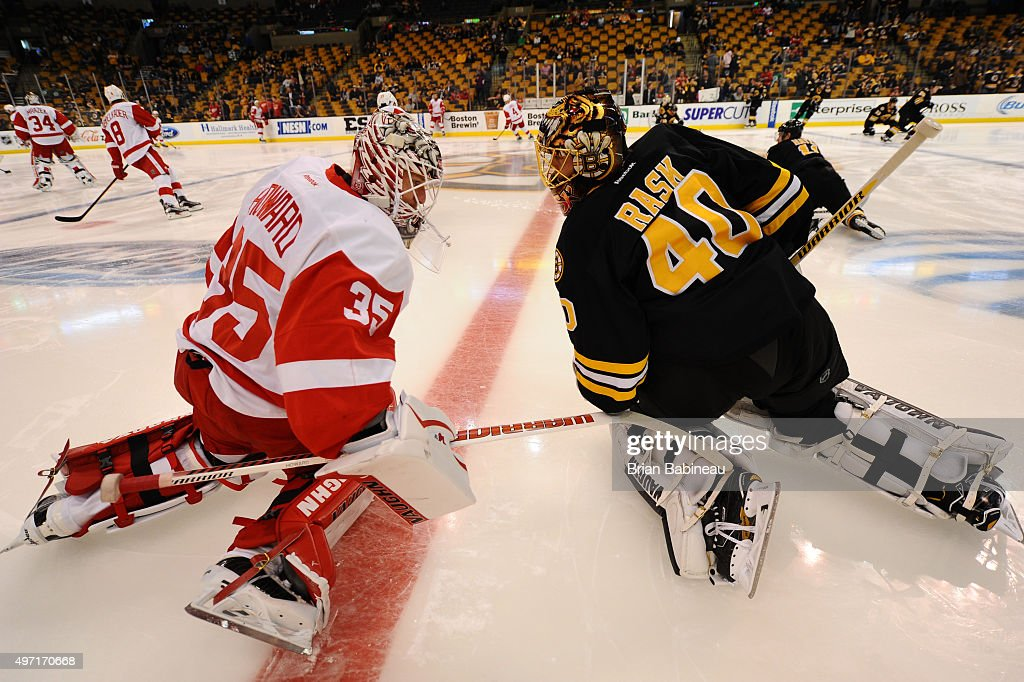 Jimmy Howard #35 of the Detroit Red Wings stretches during warm ups with Tuukka Rask #40 of the Boston Bruins at the TD Garden on November 14, 2015 in Boston, Massachusetts.