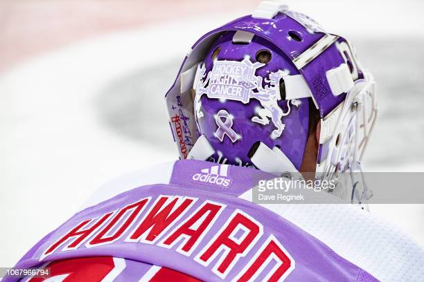 Jimmy Howard of the Detroit Red Wings stretches in warm-ups with his custom Hockey Fights Cancer jersey prior to an NHL game against the Arizona...
