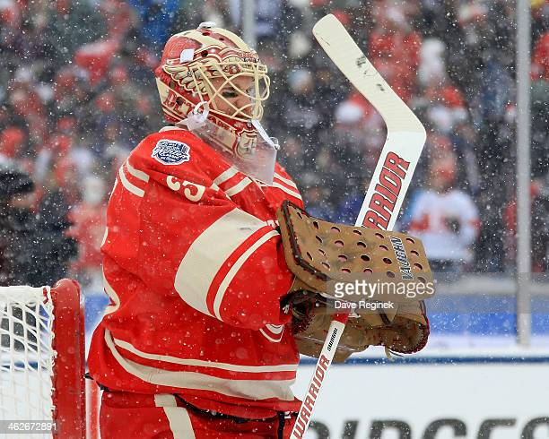 Jimmy Howard of the Detroit Red Wings tends the net in warmups before the Bridgestone NHL Winter Classic game against the Toronto Maple Leafs on...