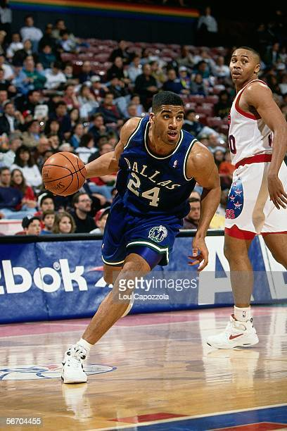 Jimmy Jackson of the Dallas Mavericks drives baseline against Clarence Weatherspoon of the Philadelphia 76ers circa 1993 at The Spectrum in...