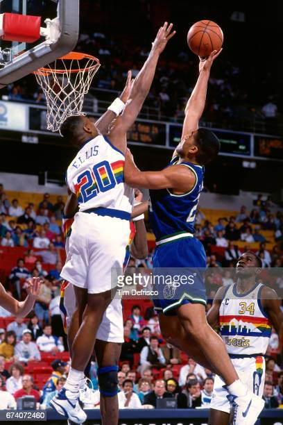 Jimmy Jackson of the Dallas Mavericks shoots against Laphonso Ellis of the Denver Nuggets circa 1995 at McNicholls Arena in Denver Colorado NOTE TO...