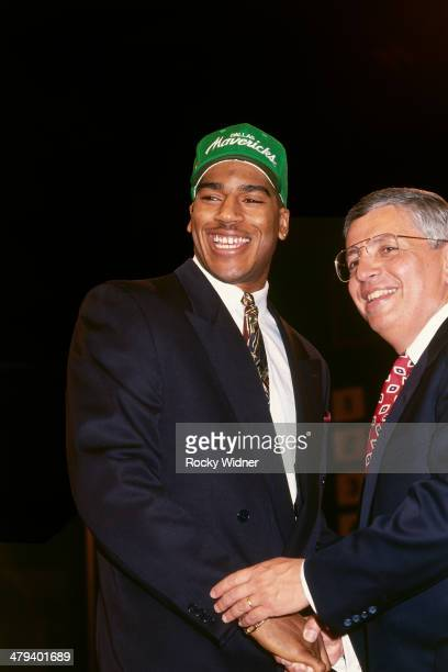 Jimmy Jackson shakes hands with NBA Commissioner David Stern after he was selected number four overall by the Dallas Mavericks during the 1992 NBA...