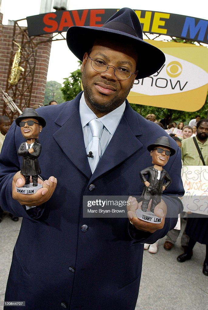 Jimmy Jam with bobble heads to be auctioned on ebay to benefit VH1's Save the Music