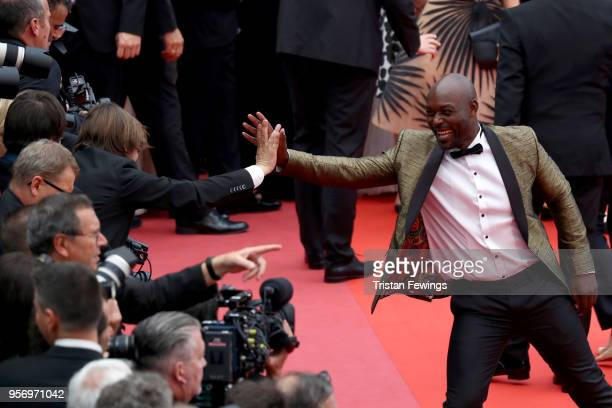 Jimmy Jean Louis greets a photographer as he attends the screening of 'Sorry Angel ' during the 71st annual Cannes Film Festival at Palais des...