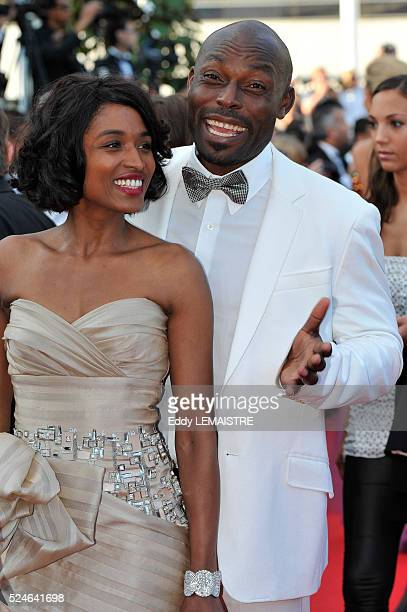 Jimmy JeanLouis and Evelyn Stock at the premiere of Of God and Men during the 63rd Cannes International Film Festival