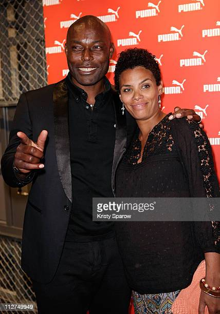 Jimmy JeanLouis and his wife Evelyn Stock attend the Puma Concept Store Inauguration on April 20 2011 in Paris France