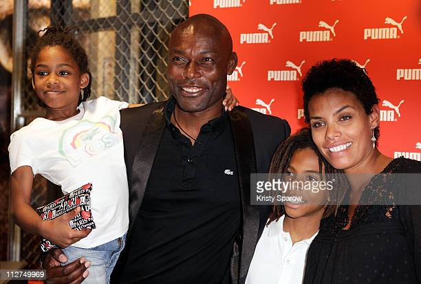 Jimmy JeanLouis and his wife Evelyn Stock pose with their daughter Jasmin and son Thevi during the Puma Concept Store Inauguration on April 20 2011...
