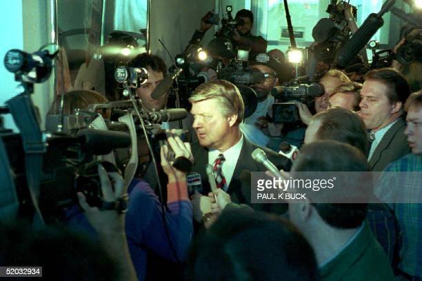 Jimmy Johnson attempts to pass through members of the media 29 March 1994 at the Dallas Cowboys headquarters in Irving Texas The Cowboys would later...