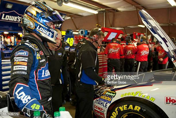 Jimmy Johnson in his garage during the NASCAR Sprint Cup car practice session for Sunday's Sylvania 300 at the New Hampshire Motor Speedway on...
