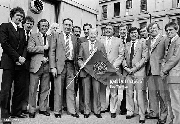 Jimmy Johnstone Jock Stein and the Celtic Team with the Sporting Lisbon flag at a function in Glasgow to celebrate the anniversary of their 1967...