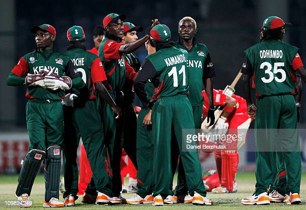 Jimmy Kamande of Kenya celebrates with team mates after running out Zubin Surkari of Canada during the ICC Cricket World Cup group A match between...