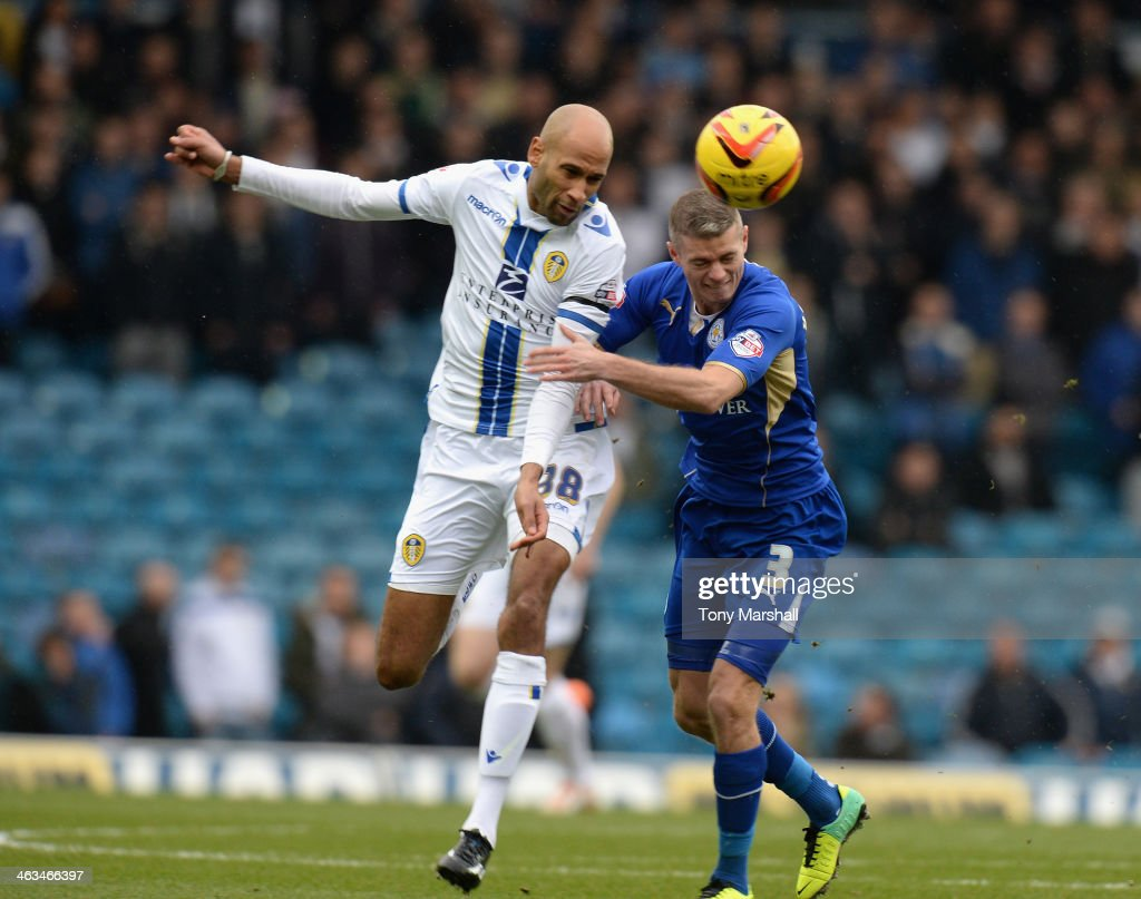 Jimmy Kebe of Leeds United wins the ball from Paul Konchesky of Leicester City during the Sky Bet Championship match between Leeds United and Leicester City at Elland Road on January 18, 2014 in Leeds, England,
