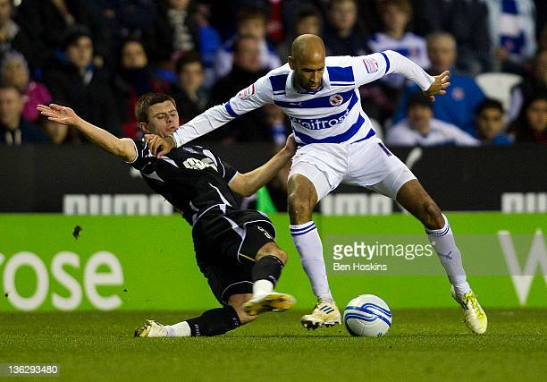 Jimmy Kebe of Reading holds off the challenge of Aaron Cresswell of Ipswich during the npower Championship match between Reading and Ipswich Town at...