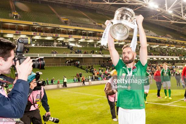 Jimmy Keohane of Cork celebrates with a trophy during the Irish Daily Mail FAI Senior Cup Final between Dundalk FC and Cork City at Aviva Stadium in...