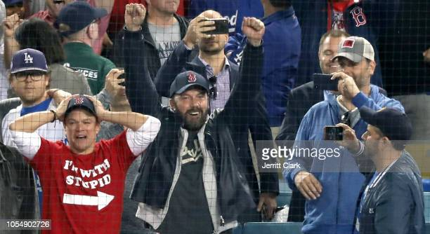 Jimmy Kimmel looks on as Matt Damon and Ben Affleck celebrate the Boston Red Sox winning the World Series v The Los Angeles Dodgers Game Five at...