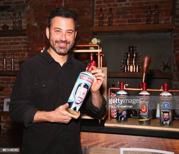 Jimmy Kimmel poses with a bottle of Smirnoff painted with his image during the Jimmy Kimmel Live Welcome to Brooklyn kickoff hosted by SMIRNOFF vodka...