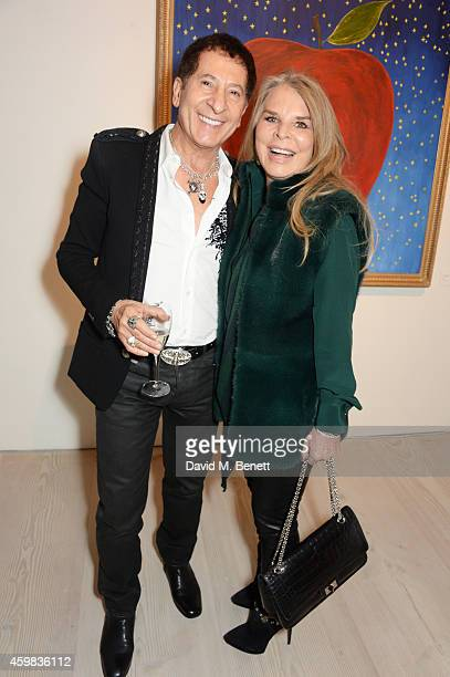 """Jimmy Lahoud and Lady Tina Green attends a private view of """"And The Stars Shine Down"""" by Stasha Palos at the Saatchi Gallery on December 2, 2014 in..."""