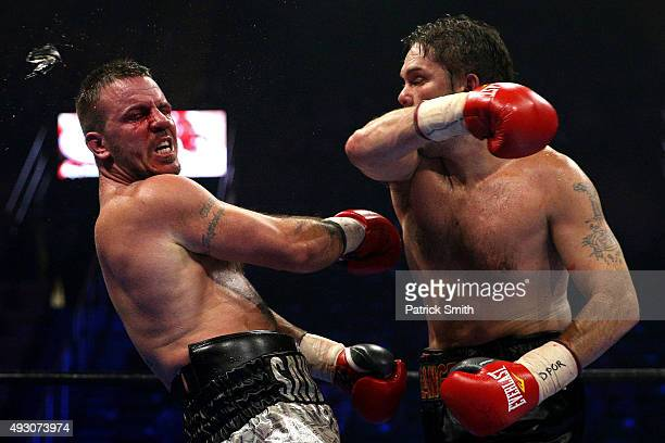 Jimmy Lange punches the mouthpiece out of the mouth of Mike Sawyer during their light heavyweights bout at EagleBank Arena on the campus of George...