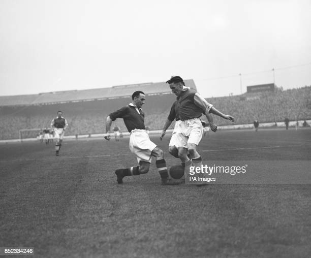 Jimmy Logie the Arsenal inside right appears to have three arms and three legs while fighting for the ball with Chelsea right back Sydney Bathgate...